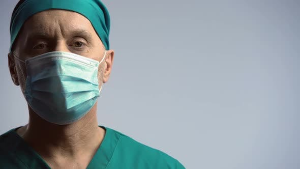 Thumbnail for Serious Face of Male Physician Looking to Camera, Warning on Epidemic, Medicine