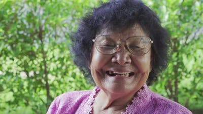 slow-motion of senior woman laughing