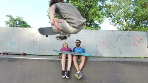Thumbnail for Friends cheering their friend who is skateboarding at skatepark
