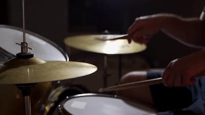 Professional Drummer Playing on Drum Set