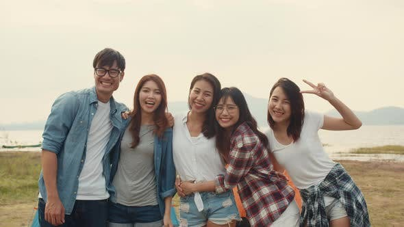 Group of Asia best friends teenagers take picture with automatic camera enjoy happy moments.