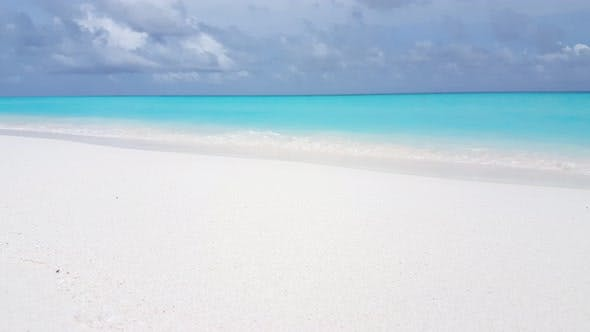 Thumbnail for Natural fly over abstract shot of a white sand paradise beach and aqua turquoise water background in