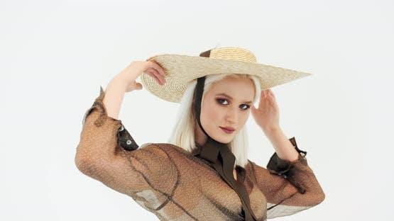 Female Model in Hat Posing in Studio