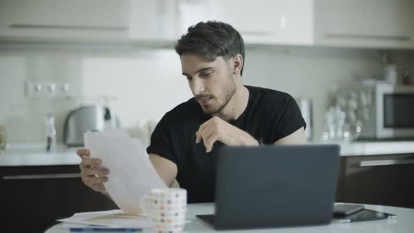 Thumbnail for Businessman Looking Paper at Home Workplace Young Business Man Work with Papers
