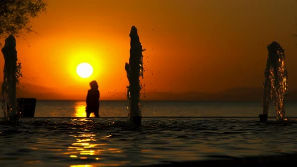 Water Fountain And Sunset