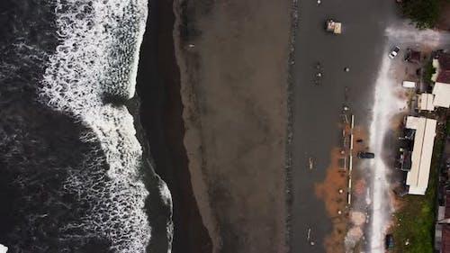 Birds Eye View Along Black Sand Beach Bali