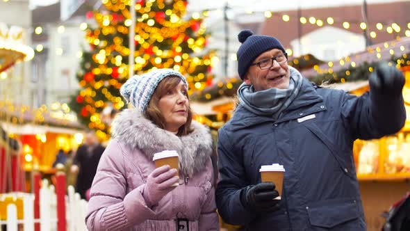 Thumbnail for Senior Couple with Hot Drinks at Christmas Market
