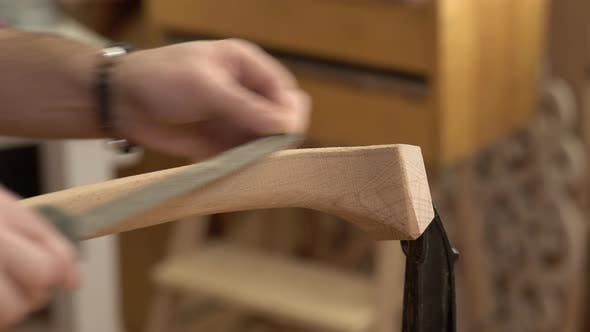 Thumbnail for Carpenter Polishes Cabrioli Leg in his Workshop