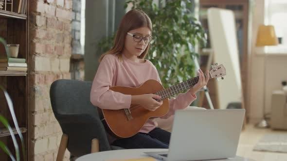 Thumbnail for Girl Playing Ukulele