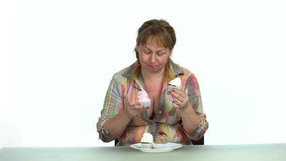 Fat Woman Sitting and Eating Sweet Food