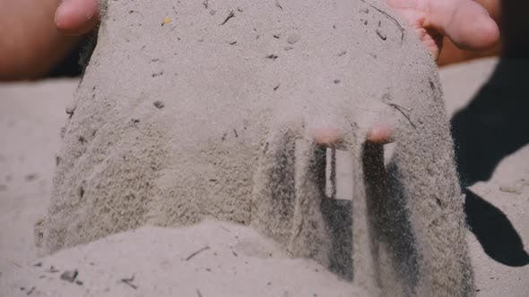 Thumbnail for Male Hands Falling Sand on the Beach in Slow Motion. Dirty Sand in the Hands of Men
