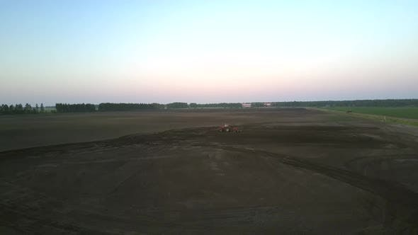 Thumbnail for Field Plowing with Cultivator Against Sunset Aerial Panorama
