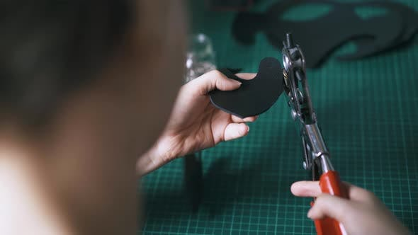 Thumbnail for Experienced Tailor Makes Holes in Black Leather Cat Mask Ear