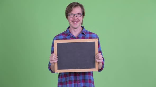 Cover Image for Happy Young Handsome Hipster Man Holding Blackboard