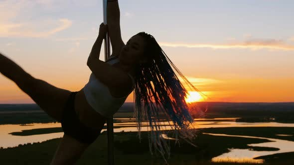 Thumbnail for Pole Dance on Orange Sunset - Attractive Woman with Long Braids Dancing