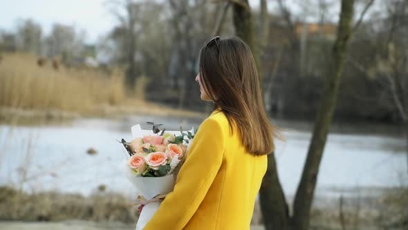 Thumbnail for Portrait of Girl Walking on the River Beach with Flowers, Relationship Hard Concept Outdoors