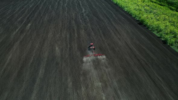 Thumbnail for Cultivating Land for Agricultural Crops Using a Tractor. Aerial View of the Sowing Field. View From