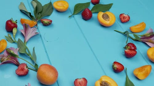 Apricot Strawberry on Blue Wooden Background