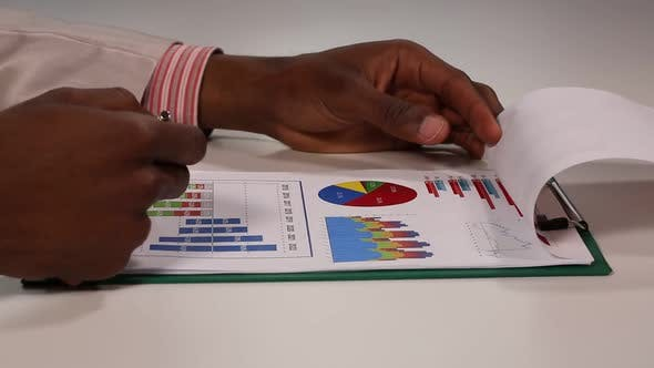 Thumbnail for Businessman Working with Charts