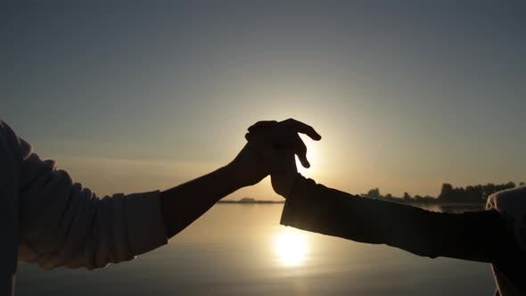 Thumbnail for Silhouette of Hands Hold Together at Sunrise