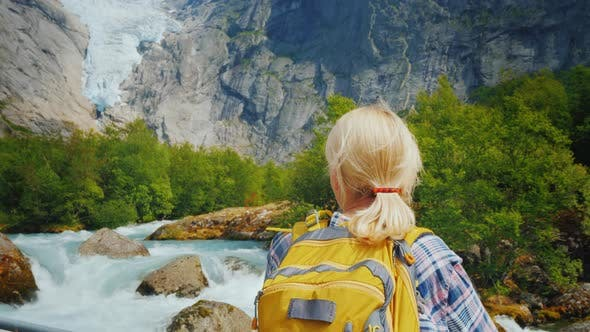 Thumbnail for Active Woman on a Trip To Norway. Enjoys the Beautiful Briksdal Glacier
