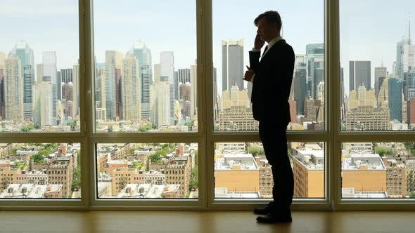 Thumbnail for Young Businessman Talking on Mobil Phone