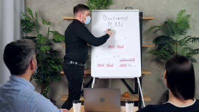 Businessman presentation strategy business plan company, writes on whiteboard