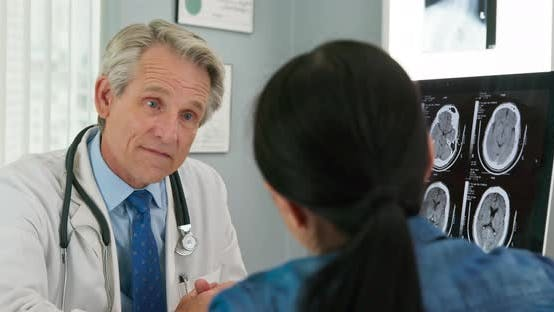 Thumbnail for Doctor and patient having discussion about health care options in medical office