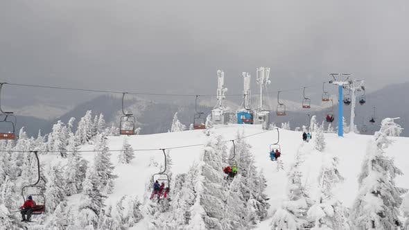 Thumbnail for People on a Ski Lift