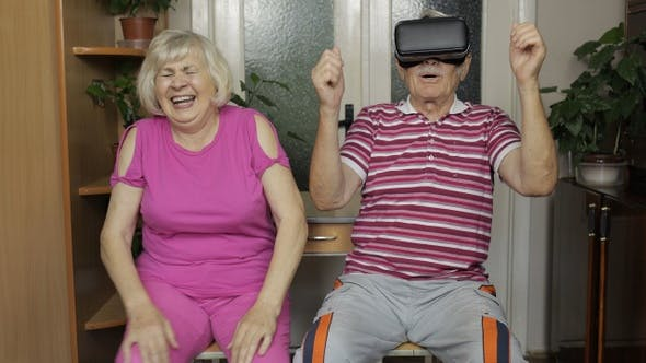 Thumbnail for Grandmother Puts on Grandfather Helmet for VR Headset. Playing, Watching Videos in Virtual Reality