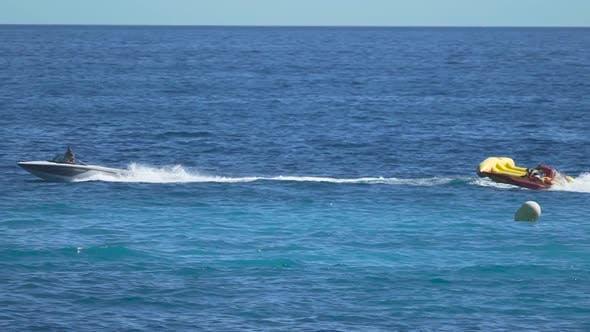 Thumbnail for Happy People Enjoying Banana Boat Ride, Cool Attraction at Sea Resort, Summer