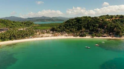 Las Cabanas Beach at El Nido At, Philippines