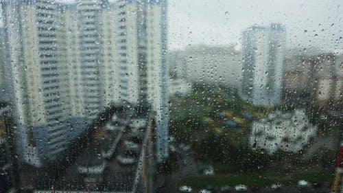 Raindrops run down the window pane on a rainy day