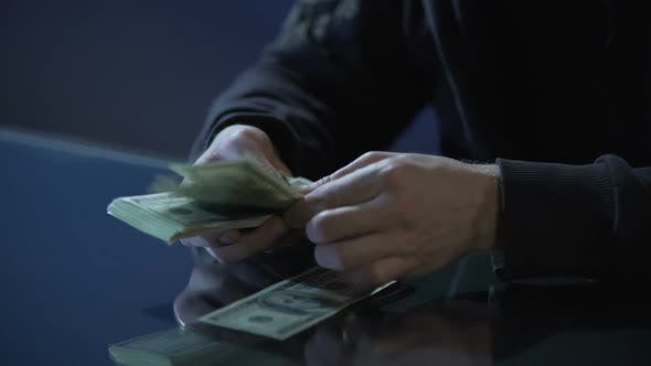 Thumbnail for Hands of Contract Killer or Bank Robber Counting Money Paid for Committing Crime