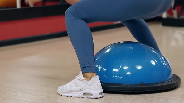 Slow Motion Close View Girl Slim Legs Jump on Stability Ball
