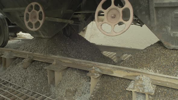 Close up of cement wagons unloading hopper