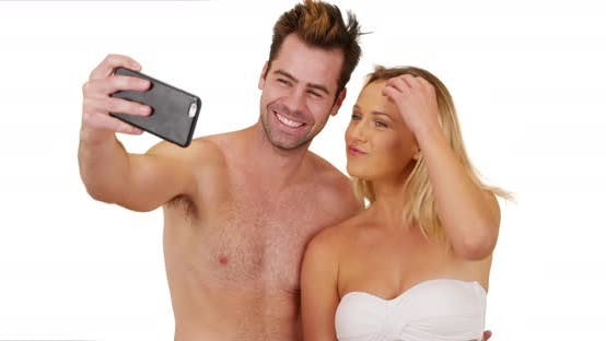 Thumbnail for Young social media obsessed couple taking selfies to post online