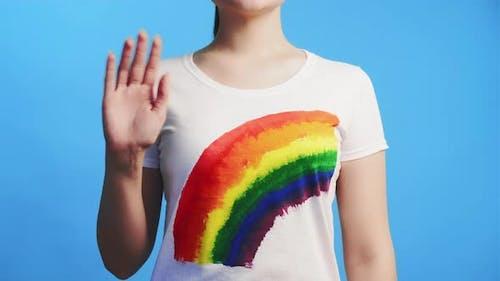 Lgbt Solidarity Woman in Rainbow Tshirt Waving Hi