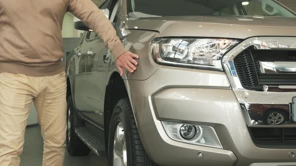 Thumbnail for A Nice Man Comes To a New Car and Strokes the Automobile with His Hand