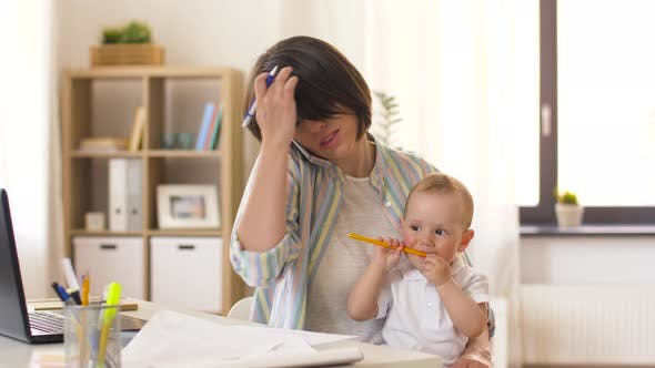 Working Mother with Baby Calling on Smartphone