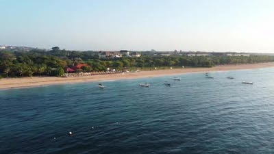 Drone Flying Along the Beach with Hotels