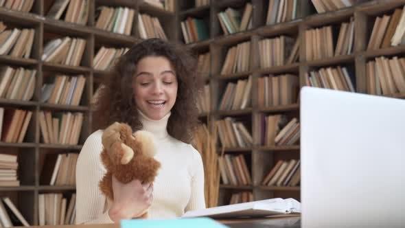 Young Hispanic Female Teacher Reading Fairy Tale Book Teaching Children in Zoom