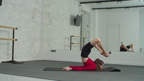 Flexible Sporty Female Practicing Backbend Yoga Pose