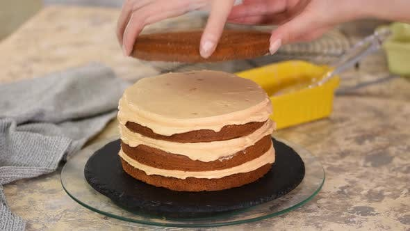 Thumbnail for Girl making a caramel cake in a bakery