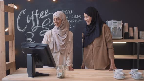 Thumbnail for Female Muslim Coworkers At Coffee Shop