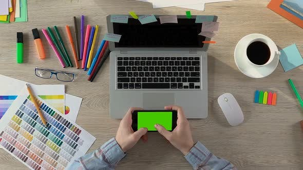 Thumbnail for Freelancer Sitting at Table and Typing Message on Smartphone, Creative Person
