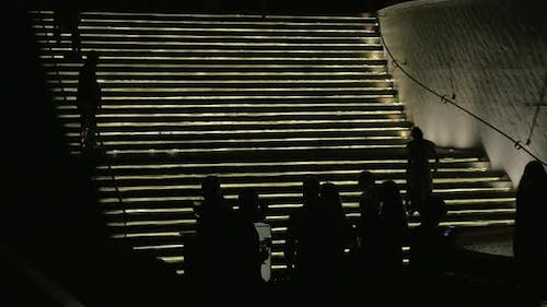 Drinking silhouettes of people against lighting stairway Bangkok, Thailand