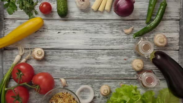 Thumbnail for Cook Putting Plate with Freshly Cooked Salad on Table with Ingredients