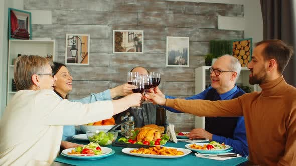 Thumbnail for Happy Family During Lunch Toasting with Red Wine