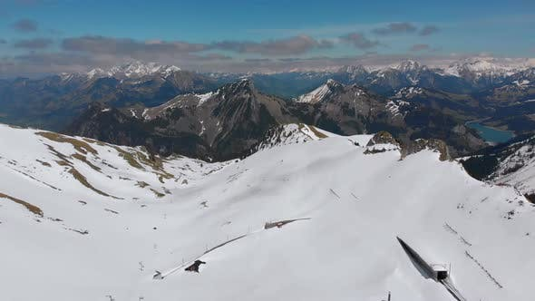 Thumbnail for Aerial Drone View on Snowy Peaks of Swiss Alps. Switzerland. Rochers-de-Naye Mountain Peak.